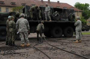 Soldiers from 357th Air and Missile Defense Detachment Brigade, 5th Battalion, 7th Air Defense Artillery Regiment, ALPHA Battery, familiarizes members of the Polish Military on how to conduct preventive maintenance on the Patriot Missile systems